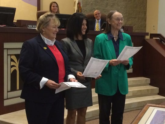 Susan Marie Weber, from left, Gina Nestande and Kathleen Kelly are sworn in as Palm Desert City Council members on Thursday, Dec. 8, 2016, at City Hall. All three are up for re-election in November 2020, but whether they run may be determined by district boundaries, still to be decided, as part of a lawsuit settlement.