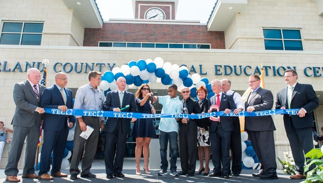 Cumberland County Technical Education Center freshman Cassius Ali-Garcia cuts the ribbon with Superintendent Dr. Dina Rossi Elliot during the opening at Cumberland County Technical Education Center on Thursday, September 8.