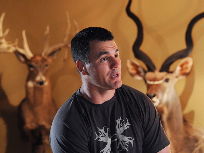 Indianapolis Colts kicker Adam Vinatieri has a love for hunting, big game hunting. His office in his Carmel home is decorated wall to wall with his hunting trophies. Matt Kryger / The Star