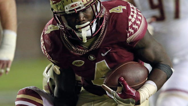 Florida State's Dalvin Cook set the school career rushing record with 4,319 yards.