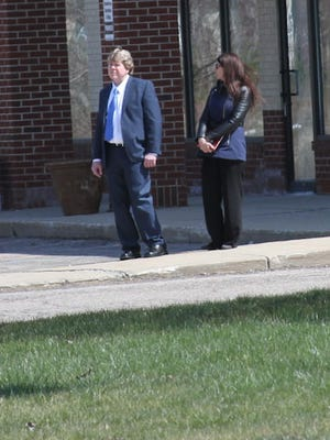 Steven Kelty, left, stands next to his attorney, Heather Nalley, as the jury in his trial walks around the Latson Road and Figurski Drive intersection in Genoa Township on Thursday.