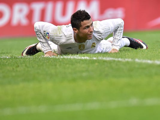 Real Madrid's Cristiano Ronaldo of Portugal, laments after missing a goal during their Spanish La Liga soccer match, between SD Eibar and Real Madrid, at Ipurua stadium in Eibar, northern Spain, Sunday, Nov. 29, 2015. Real Madrid won the match 2-0. (AP Photo/Alvaro Barrientos)