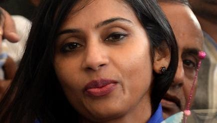 Indian diplomat Devyani Khobragade arrives at the domestic airport in Mumbai in this Jan. 14 photo.  A New York grand jury re-indicted Khobragade on Friday, accusing her of mistreating her housekeeper on two counts of visa fraud and making false statements.