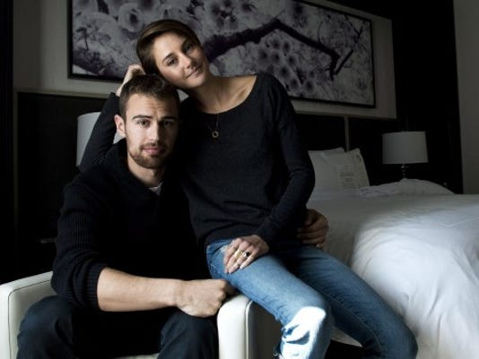"""Actors Theo James, left, and Shailene Woodley pose for a photograph as they promote the movie """"Divergent,"""" in Toronto on Thursday, March 6, 2014. (AP Photo/The Canadian Press, Nathan Denette)"""