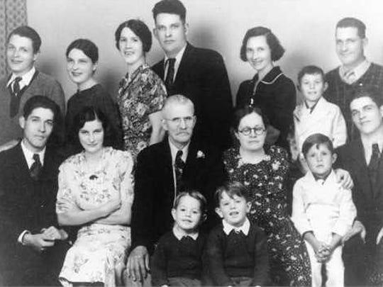 The Oakes family portrait was taken in June 1938. Back row: Elliott, Mildred, Marion (Albert Jr.'s wife), Albert Jr., Myrtle (Milton's wife), Jerry (Milton's son), Milton. Next row: Raymond, Veda (Raymond's wife), Albert, Sr., Pearl, Roy (Milton's son), Gordon. Front row: Arthur and Billy (Albert Jr.'s sons).