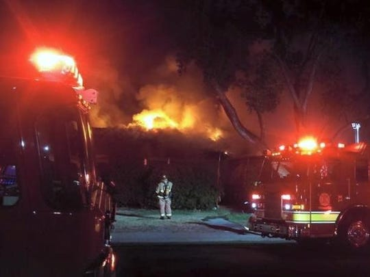 Nick de la Pena, a resident of the 2200 block of South Terrace Street in Visalia, took this photo of firefighters battling a fire at his neighbor's house Saturday night.