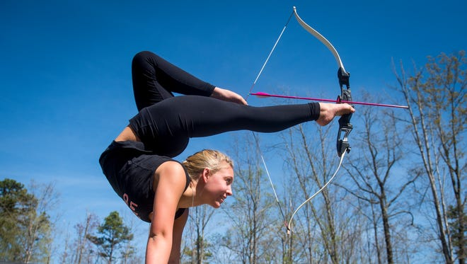Corrinne Calhoun is a dancer and she is a foot archer, which means she can do a handstand and then shoot an arrow from a bow using her feet.