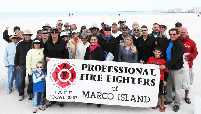 Marco Island Fire-Rescue Department personnel along with family and friends came together with the Beach Advisory Committee last weekend to help clean up the Marco Beach.