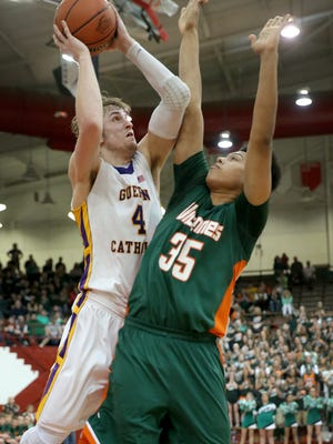 Guerin Catholic Golden Eagles Matt Holba puts up a shot on Vincennes Lincoln Alices Anthony Smith,right, in the second half of their IHSAA Boys 3A Semi-State basketball game Saturday, March21, 2015, afternoon at Southport High School.