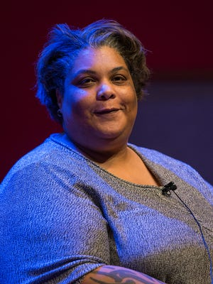 Author Roxane Gay takes an audience question at the Central Library in downtown Indianapolis, Tuesday, Jan. 24, 2017.