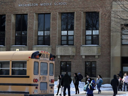 Students leave Washington Middle School  at the end