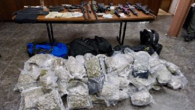 A long-term investigation led to the arrest of a Lafayette man and the seizure of more than $800,000 in illegal narcotics and 13 firearms.