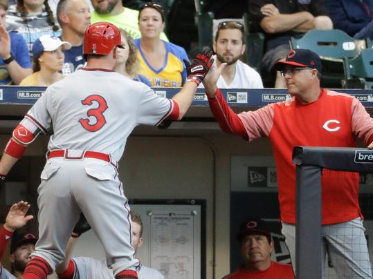 Cincinnati Reds manager Bryan Price congratulates Patrick Kivlehan (3) after his two-run home run during the fourth inning of a baseball game against the Milwaukee Brewers Saturday, Aug. 12, 2017, in Milwaukee. (AP Photo/Morry Gash)