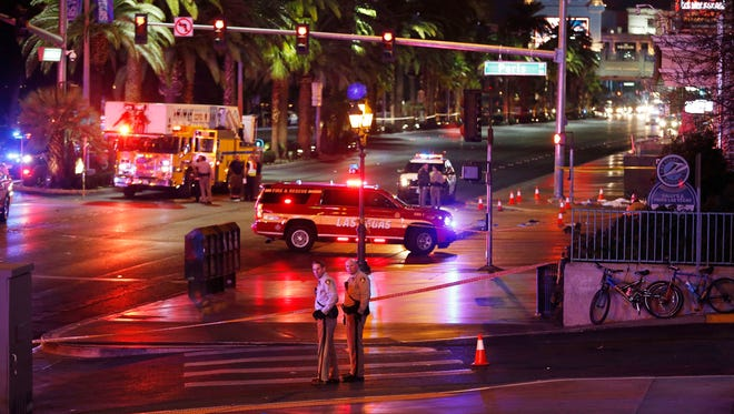 Police and emergency crews respond to the scene of a car accident along Las Vegas Boulevard,  Dec. 20, 2015, in Las Vegas.
