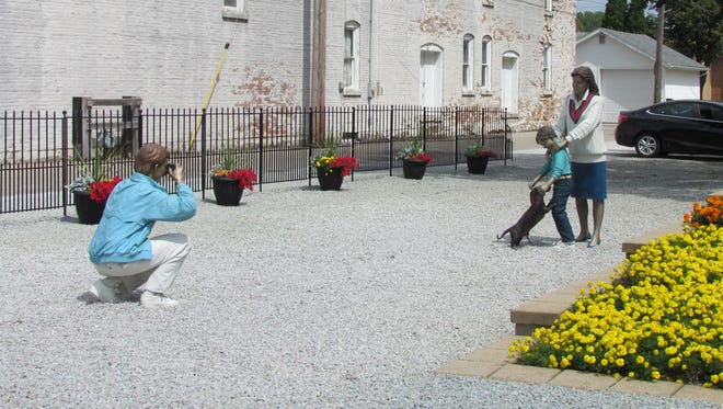 """Some of Seward Johnson's sculptures in Elkhart County are so lifelike that one in our party commented, """"we should wait to go over there until the family is done shooting its photo."""" This is called Photo Shoot and was in Wakarusa."""
