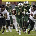 Nov 14, 2015; Tampa, FL, USA; South Florida Bulls quarterback Quinton Flowers (9) carries the ball in the second quarter against the Temple Owls at Raymond James Stadium. Mandatory Credit: Logan Bowles-USA TODAY Sports