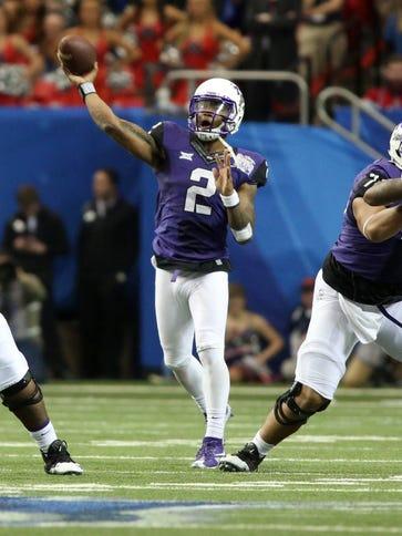 TCU quarterback Trevone Boykin throws the ball against