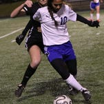 Lady Chiefs freshman Abigail Africa tries to keep the ball away from Benton Tigers freshman Annalee Ward during a soccer game at West Ouachita on Tuesday, Feb. 9, 2016. The Lady Chiefs won 3-1.