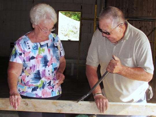 Linda and Jerry Comfort, of Horseheads, members of Full Gospel Church in Beaver Dams, work on a project in the basement of the new church parsonage.