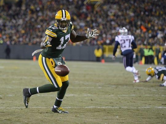 Green Bay Packers receiver Davante Adams (17) drops