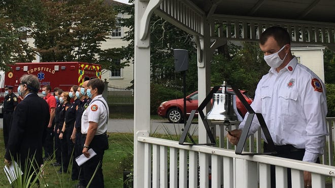 Topsfield Fire Captain Conor Brown rings the bell.