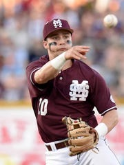 Mississippi State shortstop Ryan Gridley throws out an Ole Miss hitter.