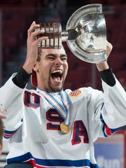 United States' Jordan Greenway hoists the trophy after
