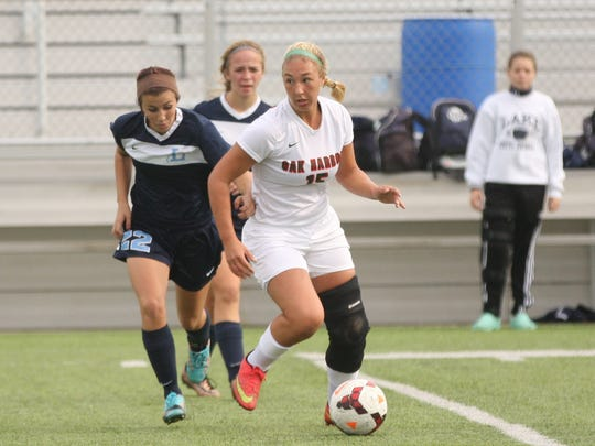 Oak Harbor's Maddy Rathbun has a little space to operate against Lake.