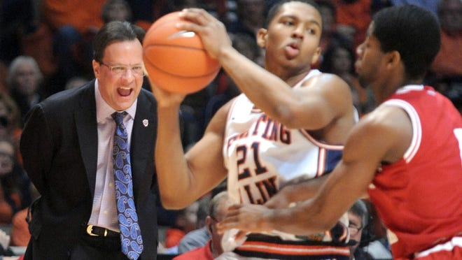 Indiana coach Tom Crean, left, reacts to his team's play during an NCAA college basketball game against Illinois in Champaign, Ill., Sunday, Jan. 18, 2015.