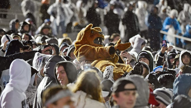 The Nittany Lion crowd-surfs through the student section during the second half of an NCAA Division I football game Saturday, Nov. 18, 2017, at Beaver Stadium. Penn State defeated Nebraska 56-44 in its final home game of the 2017 season.