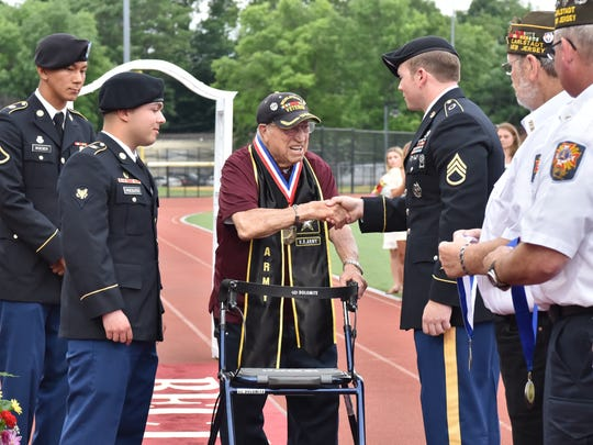 Vito Trause, a 93-year-old veteran, receives his high school diploma from Becton Regional High School in East Rutherford. Mr. Trause served in the WWII war and was a German Nazi prisoner.