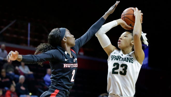 Michigan State forward Aerial Powers (23) takes a shot past Rutgers forward Kahleah Copper (2) during the first half Thursday in Piscataway, N.J.