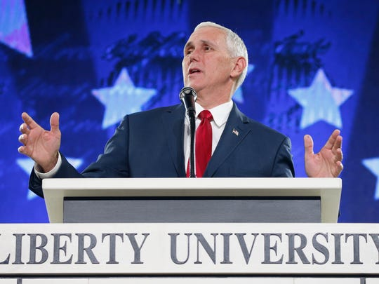 Republican Vice Presidential candidate, Indiana Gov. Mike Pence, gestures as he speaks at Liberty University in Lynchburg, Va., Wednesday, Oct. 12, 2016.