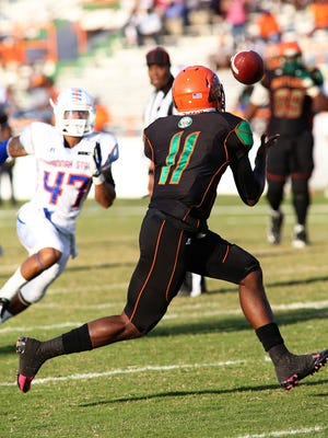 Quarterback Damien Fleming waits for the pass to complete the Rattlers' first trick play in Earl Holmes' era.