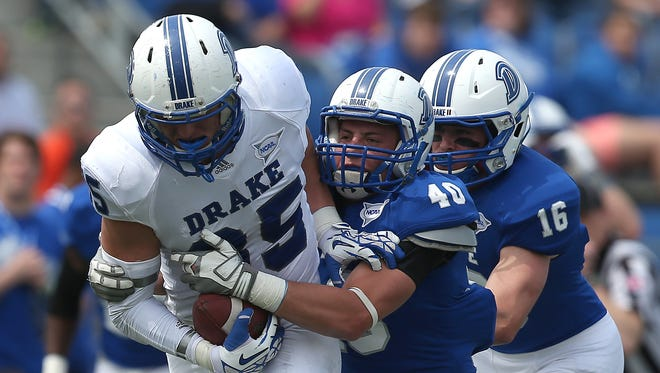 Drake player, shown during spring drills, play Pioneer Football League foe Dayton Saturday.