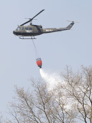 A Forest Fire Service helicopter, like this one pictured in 2014, was among the equipment used in the Woodmansie fire in Ocean and Burlington counties.