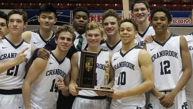 Bloomfield Hills Cranbrook Kingswood's players proudly display the championship trophy after winning the program's first Catholic League title Sunday afternoon at Calihan Hall.