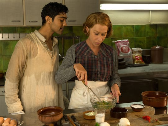 "Manish Dayal and Helen Mirren in ""The Hundred-Foot Journey."""