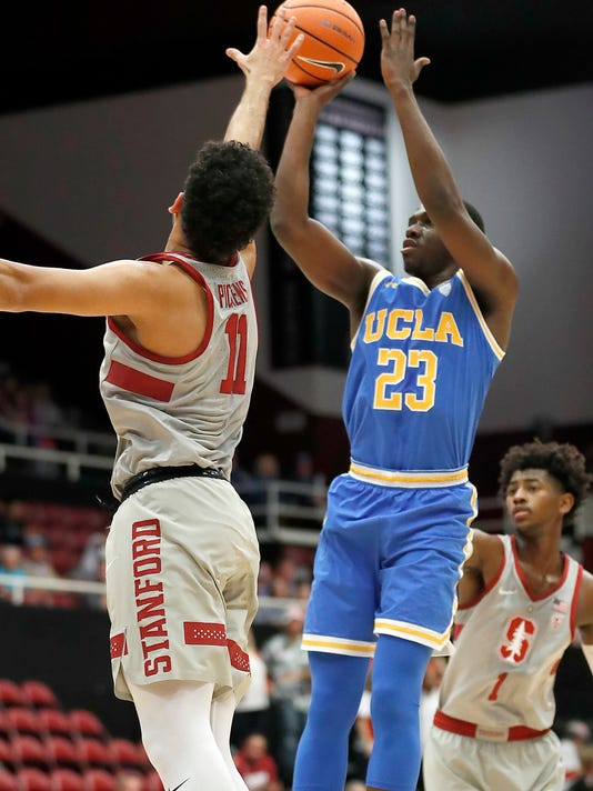 UCLA guard Prince Ali (23) shoots over Stanford guard Dorian Pickens (11) during the first half of an NCAA college basketball game Thursday, Jan. 4, 2018, in Stanford, Calif. (AP Photo/Tony Avelar)