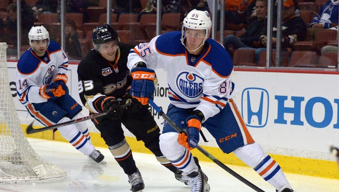 Edmonton Oilers defenseman Martin Marincin (85) is defended by Anaheim Ducks right wing Jakob Silfverberg (33) at Honda Center.