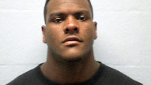 This photo released by the Erie County sheriff's department in Sandusky, Ohio, shows Frank Clark, 21, of Ypsilanti, Mich. The University of Michigan defensive end is being held without bond Sunday, Nov. 16, 2014, in the Erie County jail in Sandusky, Ohio after he was arrested Saturday on a domestic violence charge.