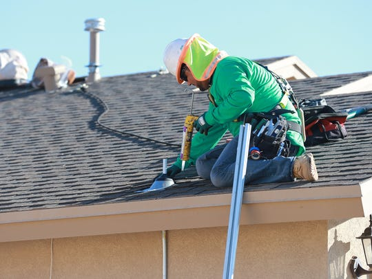 SolarCity worker Chris Villarreal prepared a home roof