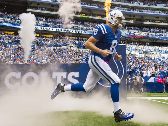 Indianapolis Colts quarterback Matt Hasselbeck (8) races onto the field during team introductions of an NFL football game at Lucas Oil Sunday, Oct. 4, 2015.