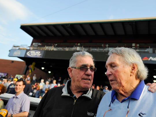 Former York Revolution manager Andy Etchebarren greets Hall of Fame third baseman Brooks Robinson on the field at Sovereign Bank Stadium before a pre-game ceremony during which their numbers, as well as Jackie Robinson's, were retired.