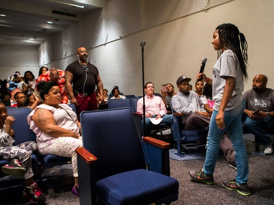 Howard High School of Technology sophomore Alexandrea Rogers speaks to community members at a community town hall meeting on the death of Howard student Amy Inita Joyner-Francis at Stubbs Elementary School on Monday evening.