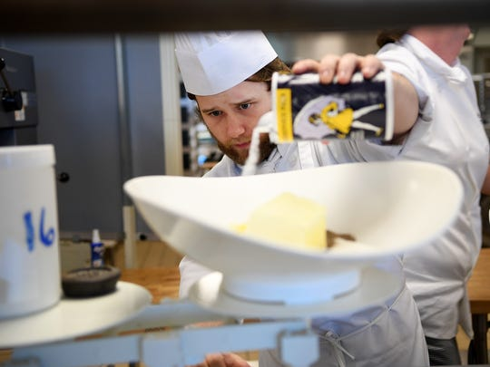 Culinary Institute of the Carolinas student Corey Saindon  measures ingredients during a bake shop production class at the Greenville Technical College Northwest campus on Wednesday.