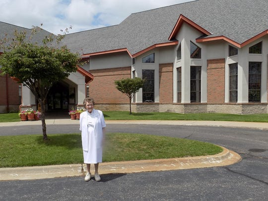 Sister Colette in front of the Motherhouse in Oxford.