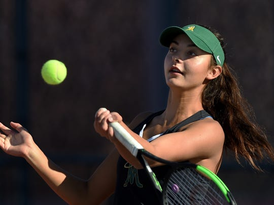 Bishop Manogue's Tara Chilton hits a forehand return during a match at Wooster last week.