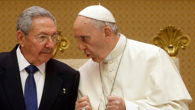 Pope Francis talks with Cuban President Raul Castro during a private audience at the Vatican on  May 10.