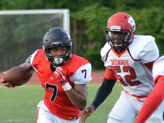 Jamal Allen (7) shows his running power and explosiveness during the 2016 season for Livonia Churchill.